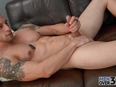 Muscular solo guy is smooth and sexy as he strokes tubes