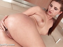Oiled up girl in pigtails masturbates shaved pussy tubes