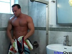 Smooth muscle man takes a shower and strokes tubes