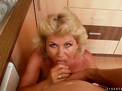 Big tits granny gives blowjob in the kitchen tubes
