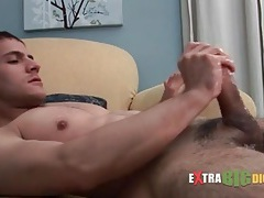 Fit guy masturbates his oiled up cock tubes