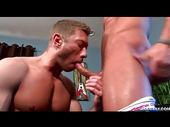 Muscular cocksucker on his knees eating meat tubes