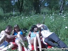 Teens on a picnic have sex in a group video tubes