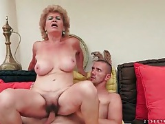 Wrinkled granny with big tits rides her man tubes