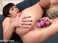 Purple dildo fills soaking wet young pussy tubes