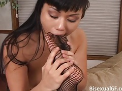 Two asian girls playing with there feet tubes