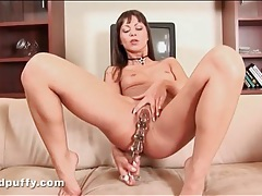 Tight young pussy pleasured by a dildo tubes