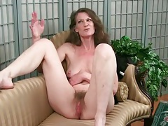 Mature strips nude to show her hairy pussy tubes