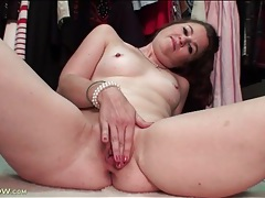 Milf strips naked in her closet to model little tits tubes