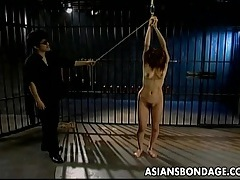 Asian chick sexually pleased in bondage tubes