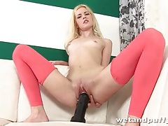 Skinny girl cunt sits on big black dildo tubes