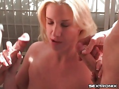 Blonde sits on a dick and sucks two others tubes