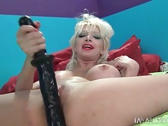 Milf in whore makeup fucks her pussy with a big toy tubes