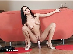 Busty babe rides a dildo and pisses on it tubes