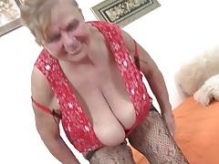 Granny fondles her big fat tits in solo porn tubes