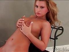 Naked big tits blonde sensually poses and plays tubes