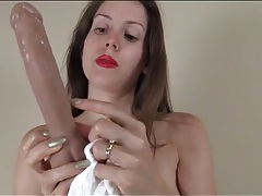 Lelu love fucks a dildo deep into her pussy tubes