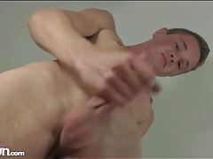 Twink masturbates his hard dick in close up tubes