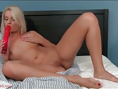 Big red dildo fucks hot cunt of a solo girl tubes
