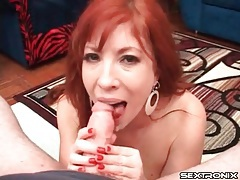 Redhead milf with arousing big tits gives a handjob tubes