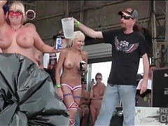 Naked redneck chicks dance and get wet on stage tubes