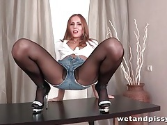 Sexy girl in black pantyhose pisses lustily tubes