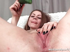 Brunette fucks a cucumber into her hot cunt tubes