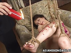 Desirable japanese sweety moans while being glazed in hot wax tubes