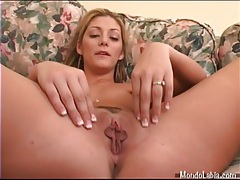 Blonde pumps and pulls on her pussy lips tubes