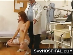 Girl in white stockings gets a doctor exam tubes