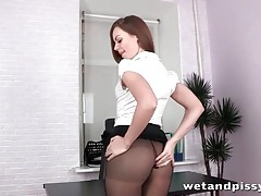 Secretary in pantyhose pees on her desk tubes