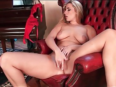 Blonde strips off stockings and fingers her pussy tubes