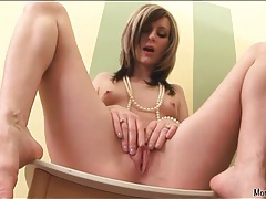 Skinny tattooed girl fingers her beautiful cunt tubes