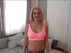 Blonde with big tits in a sexy sports bra tubes