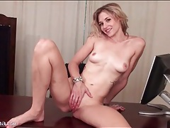 Cute young blonde plays with her pussy lips tubes