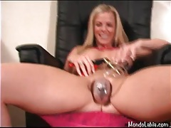 Busty girl pumps her labia with a toy tubes