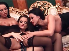 Three lesbians in black have strapon sex tubes