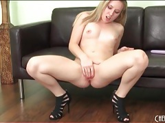 Masturbating girl in sexy black heels squirts tubes