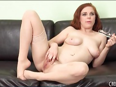 Sexy solo redhead in sheer stockings tubes