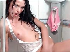 Teen masturbates wet vagina in the shower tubes