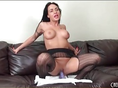 Busty chick in stockings and lipstick masturbates tubes