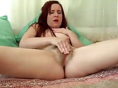 Solo redhead lustily rubs her hairy pussy tubes