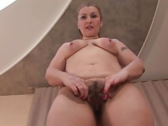 Sexy solo mommy pulls on her thick pubic hair tubes