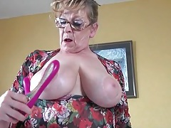 Granny in black stockings fucks a toy tubes