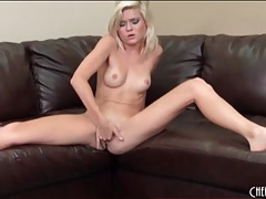 Petite blonde fingers her cunt passionately tubes