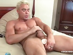 Blonde man with muscles bangs toy into his butt tubes