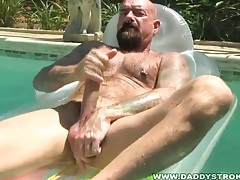 Bald macho daddy jerks off in pool tubes
