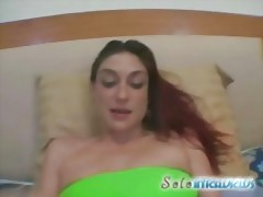 Chick oils herself up so she can finger her pussy tubes