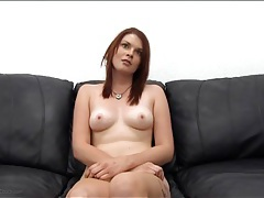 Cute curvy redhead fucked on his desk tubes