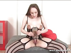 Girl in lingerie uses chopsticks on her pussy tubes